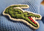 "Lacoste branded his polo shirts with a small crocodile emblem after his nickname ""the crocodile""."