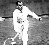 Rene Lacoste wearing the traditional long sleeve woven shirt.